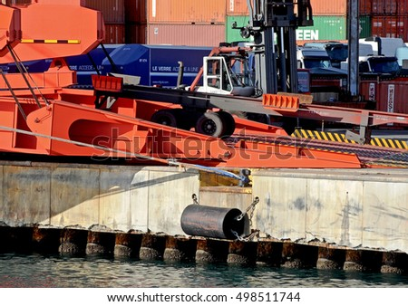 GENOA, ITALY - FEBRUARY 5, 2016: the bridge crane of a cargo ship of the shipping company Messina. Unloading of containers on trucks.