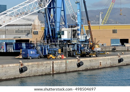GENOA, ITALY - FEBRUARY 5, 2016: The harbor of the seaside town and and the docks. In the picture, repair of a large port crane.