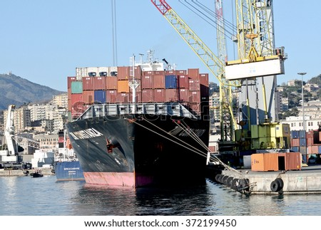 GENOA, ITALY - FEBRUARY 4, 2016: The ship Zim Costanza in the commercial port. The ship is registered in Israel and it has a total length of 249m and a maximum width of 32m and 40,542 tons.