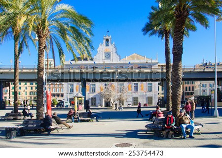 GENOA, ITALY - JAN 24, 2015: Scene of the old port, with local and tourists, in Genoa, Liguria, Italy