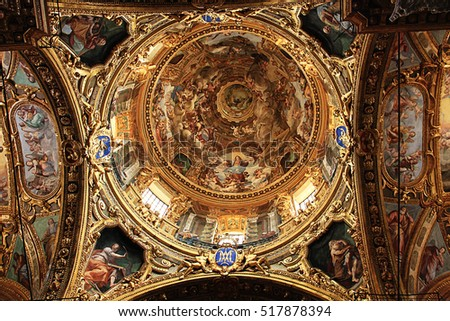 GENOA, ITALY - JULY 21, 2009 Central crossing and cupola dome with baroque paintings and golden decorations of  Santissima Annunziata del Vastato, Catholic church in Genoa built in XVII century