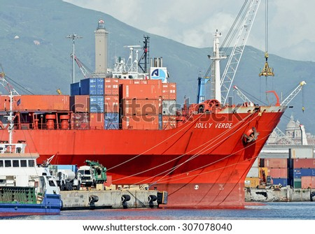 GENOA, ITALY - JULY 13, 2014: The cargo ship Jolly Arancione of the company Messina , stops at the quay. In February 2012 the ship was attacked by pirates off Somalia.