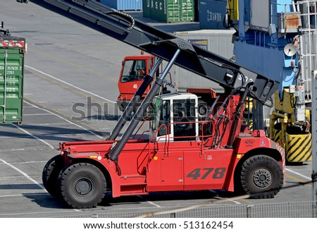 GENOA, ITALY - JUNE 25, 2013: container traffic in the port terminal of the city. In the picture, forklift at work.