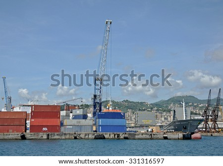 GENOA, ITALY - JUNE 5, 2014: The docks with large cranes used for handling containers in the port.