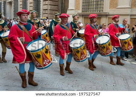 GENOA, ITALY - 8 JUNE  2014 - Unidentified men  during the historical parade of the Maritime Republics Palio