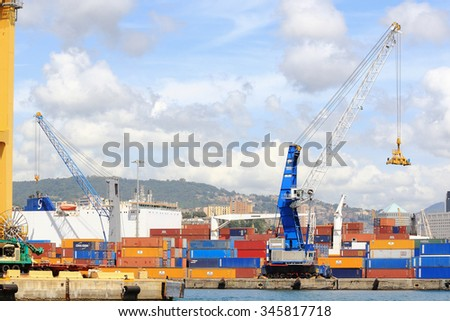 Genoa, Italy - May 6, 2014: dockers move containers on the quay of the port of Genoa
