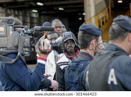 GENOA, ITALY - MAY 11, 2011: Refugees fleeing the war leaving the ship Flaminia ferry in the port of Genoa.