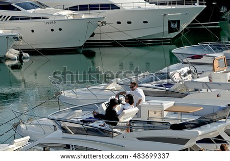 GENOA, ITALY - OCTOBER 1, 2011: 51th edition of the International Boat Show. Motor boats in water present at the boat show.