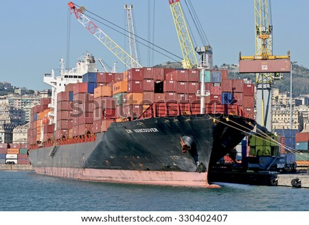 GENOA, ITALY - OCTOBER 22, 2015: The cargo ship Zim Vancouver in the containers port. The ship Zim Vancouver is a vessel built in 2007 currently sailing under the flag of Liberia.