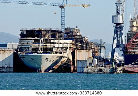 GENOA, ITALY - OCTOBER 31, 2015: The wreck of the Costa Concordia loses the bridges during the demolition. The picture shows the internal structure of the ship.