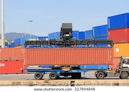 Genoa-Italy,  September 25, 2015: handling freight containers in the harbor of Genoa