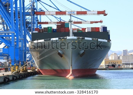 Genoa, Italy September 29, 2105: the hammersmith bridge container ship discharge containers in the port of Genoa