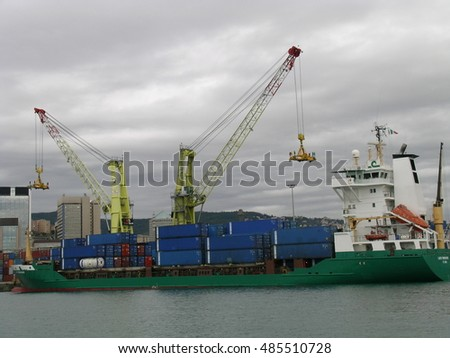 GENOVA (GENOA), ITALY - AUGUST, 2006: Cargos, containers, cranes and other mechanical loading equipment in the port of Genoa, in Liguria, Northern Italy