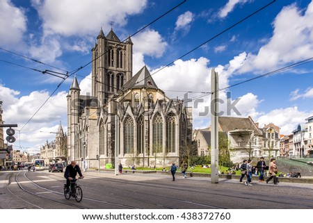 GENT, BELGIUM - APRIL 12: Urban scene of Gent in Belgium with St. Nicholas Church, one of the oldest and most prominent landmarks of Flanders on April 12, 2016. - stock photo