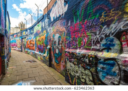 GENT, BELGIUM - JUNE 14, 2016: Graffiti street in Gent in a beautiful summer day, Belgium on June 14, 2016