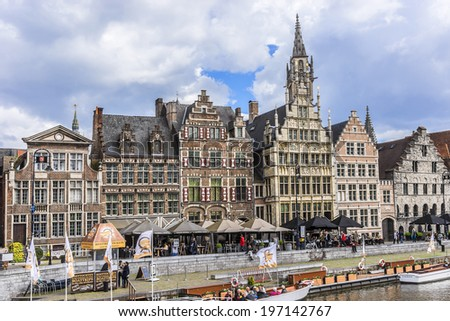 GENT, BELGIUM - MAY 12, 2014: Picturesque medieval gabled houses and tourists in city center of Gent. Ghent is the capital and largest city of the East Flanders province. Belgium.