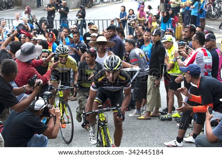 GENTING HIGHLANDS - MARCH 2: unidentified cyclists in action during stage four of the 2015 Le Tour de Langkawi (LTdL) on March 2, 2014 in Genting Highlands, Pahang, Malaysia.