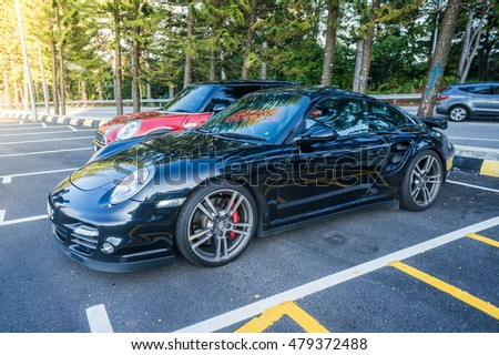 GENTING, MALAYSIA - September 4, 2016: Porsche 911 parking on the side road. Photo at Jalan Genting road 15 min to Genting Highland.