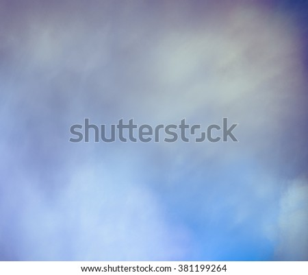 Gentle abstract background in light pastel tones, delicate and unusual. Very blurry textures. Texture similar to lightning sky. Heterogeneous grunge texture with blur and graininess