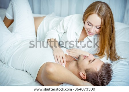 gentle and affectionate young couple in the bedroom