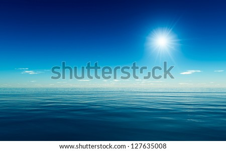 Gentle blue ocean with a bright sun flare - stock photo