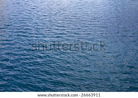 Gentle blue waves of the ocean water - stock photo