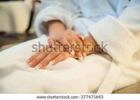 gentle bride in a dressing gown waiting for a meeting with groom