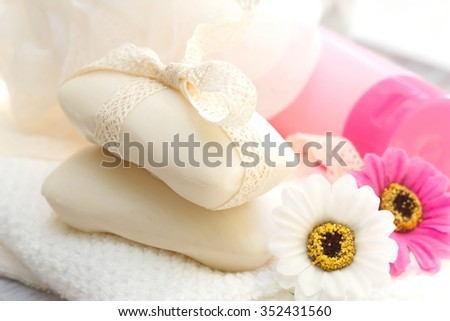 Gentle flower soap and SPA accessories - stock photo
