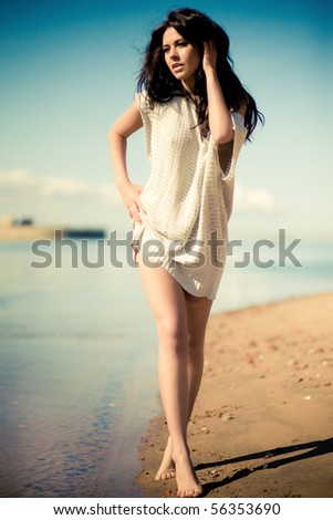 Gentle girl on the shore - stock photo