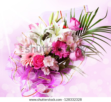 gentle pink and white spring flowers. Bouquet with red rose, alstroemeria, lily and gerberas on blur background - stock photo