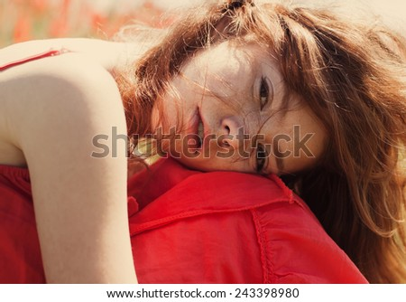 gentle portrait of a beautiful redhead girl with freckles spring - stock photo