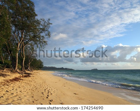 Gentle waves crash on Waimanalo Beach on Oahu, Hawaii.  Looking north towards Lanikai. - stock photo