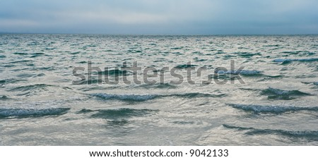 Gentle waves out to the horizon on the Atlantic Ocean