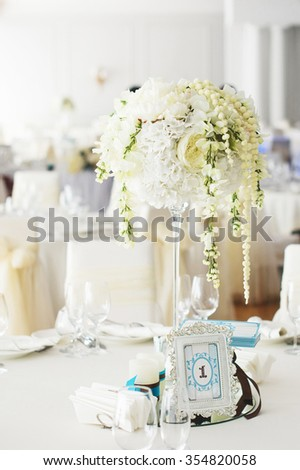 gentle white flowers in center of table