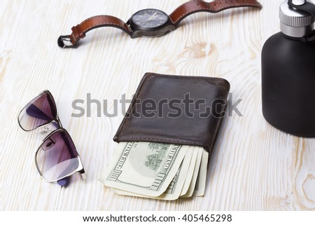 gentlemanly set:  sunglasses, perfume, wallet, watch on wooden background