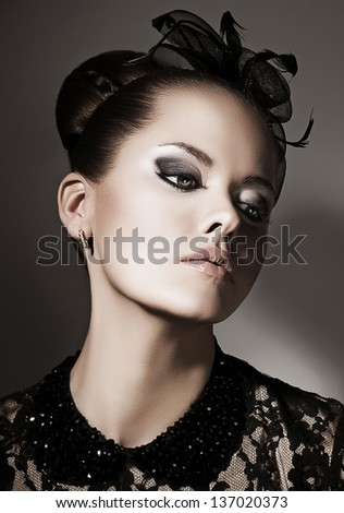 Gentleness. Portrait of Luxurious Exquisite Lady in Black daydreaming. Elegance
