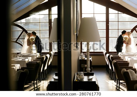 gently blonde bride and solid groom  in resturant