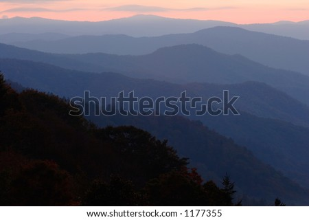Gently-curving mountain layers, painted by the light of sunrise.  Smoky Mountains NP, USA.