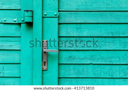 Gently restored old wooden garage plank door - stock photo