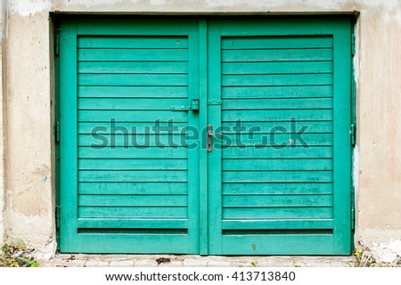 Gently restored old wooden garage plank door