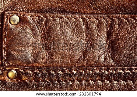 Genuine brown leather with seam. Background, pattern, texture. - stock photo