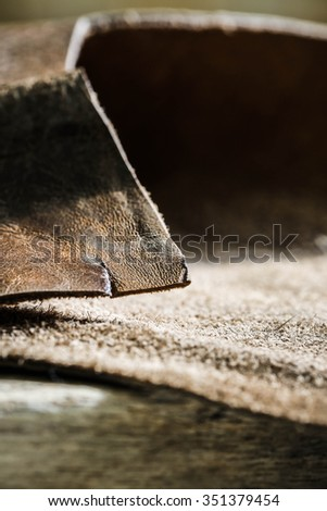 Genuine Leather and Suede, Brown. Macro, Close up Selective Focus. Concept and Idea of Fine Leather Crafting, Handmade Leather Handcrafted, Background Textured and Wallpaper. - stock photo