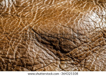 Genuine Leather Textured, Brown. Close up Shot. Concept and Idea of Fine Leather Crafting, Handmade Leather Handcrafted, Background, Pattern and Wallpaper. Full Frame Close up. - stock photo