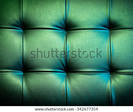 Genuine leather upholstery background for a luxury decoration in black tone - stock photo