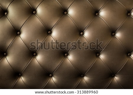 Genuine leather upholstery background for a luxury decoration in Brown tones. - stock photo