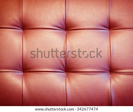 Genuine leather upholstery background for a luxury decoration in red tone - stock photo