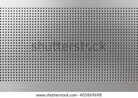 Genuine metal texture with small holes - stock photo