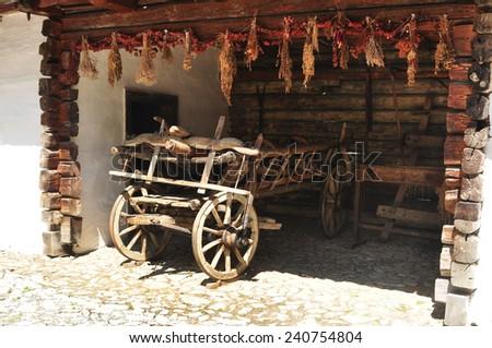 genuine romanian rustic cart museum rural exhibit - stock photo
