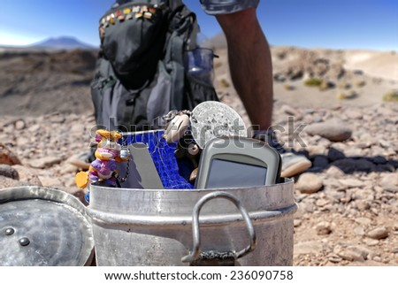 """Geocacher in the """"Atacama"""" desert stands behind the located cache. - stock photo"""