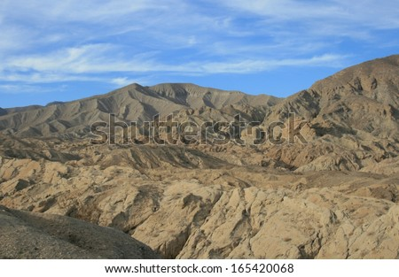 Geological badlands in the desert, California - stock photo